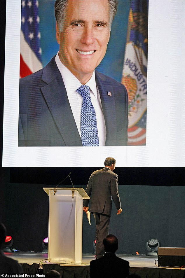 Senator Mitt Romney walks off the stage after addressing the Utah Republican Party 2021 Organizing Convention on Saturday