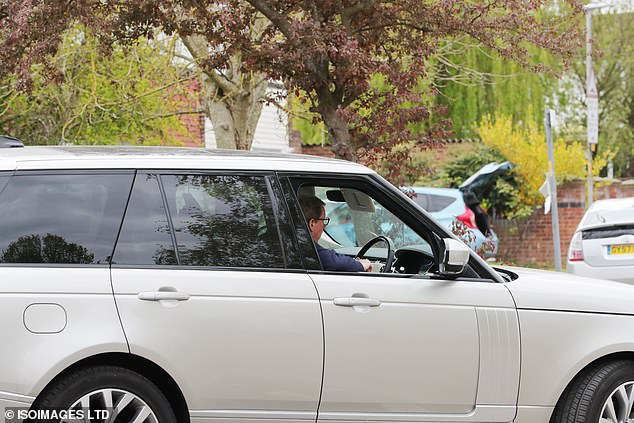 Off he goes: The new actor sported reading glasses and a navy jumper as he sat in the driver's seat