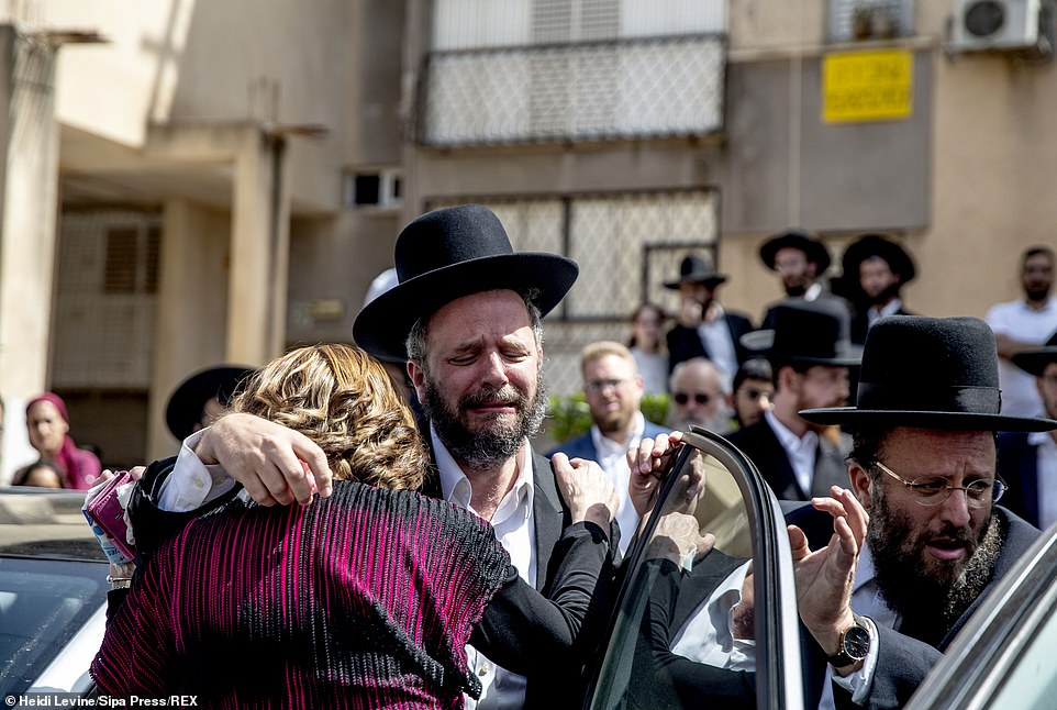 Mourners gather next to the house of Menahem Zachach, 24, who died during Lag BaOmer celebrations at Mt. Meron in northern Israel