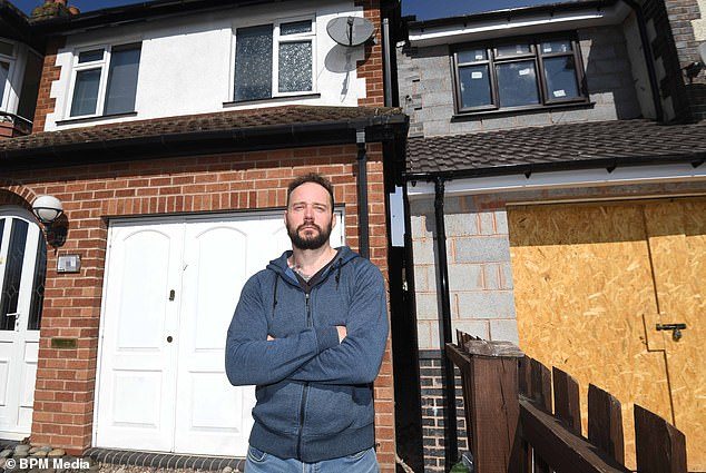 An investigation has been launched into an extension that has left a property just inches away from a neighbouring home. NHS worker Stuart Smith can no longer access the side of his house in Kings Norton, Birmingham, after a 'bizarre' extension of the property next door left only eight inches between the two homes