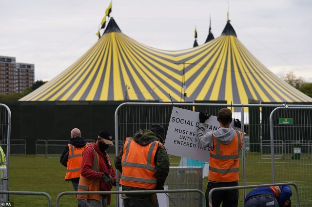 Signage being put up at a music festival in Sefton Park as part of Events Research Programme