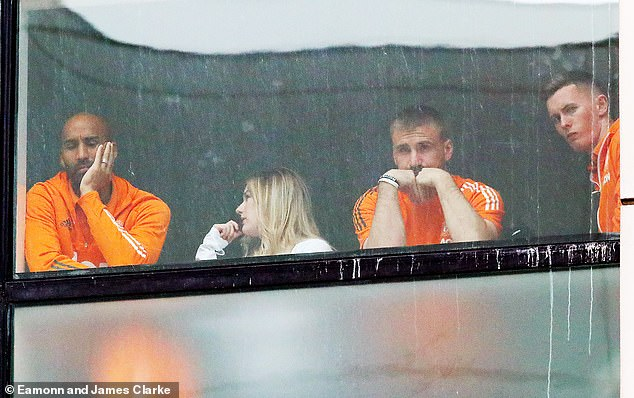 United players watched from their hotel rooms as fans gathered outside their Lowry Hotel