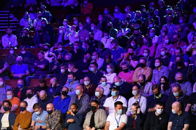 Mainly going for the blue or black: Snooker fans in masks watch on as the World Championships Final continues in Sheffield