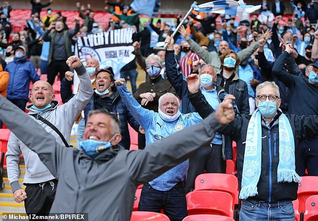 Manchester City fans celebrate scoring of the opening goal in the Carabao cup final against Tottenham Hotspur. The final was used as a test event with all those in attendance taking a Covid test beforehand