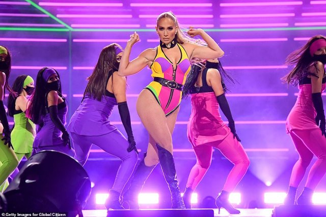 JLo's look:Lopez wore a rainbow onesie with flashes of yellow, purple, magenta and green with the same black collar with the lions head figures