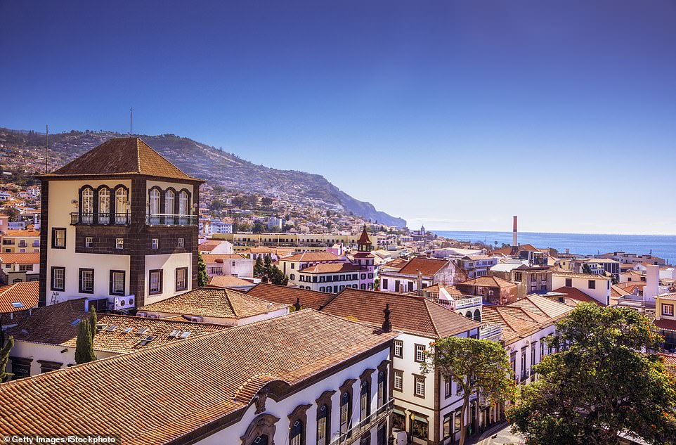 Madeira has spectacular scenery that is best explored on foot. Pictured is Funchal, the capital of Madeira