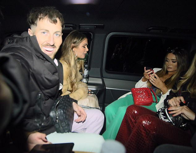 Heading home: The sisters were joined by a pal as they headed home in the taxi after their big night out