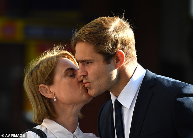 Jack de Belin was kissed by a woman before he entered court on Monday morning with the jury now deliberating the charges against him