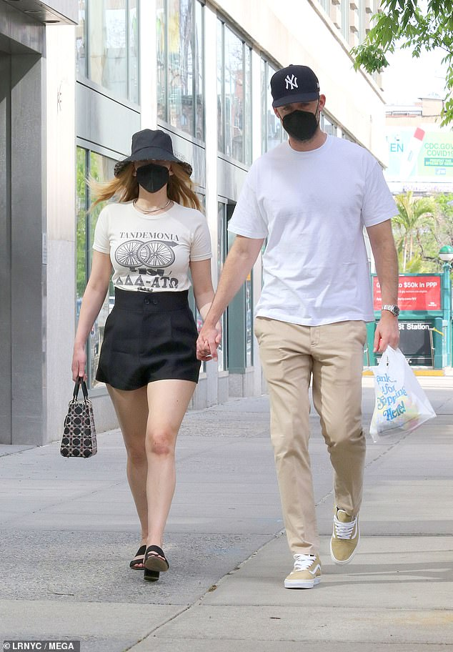 Legs get together! Jennifer Lawrence flashed her legs in a chic pair of high-waisted shorts as she held hands with her husband Cooke Maroney in New York on Saturday