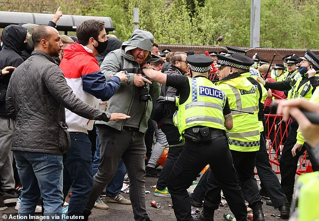 Tensions escalated when police moved in to move the protestors away from Old Trafford