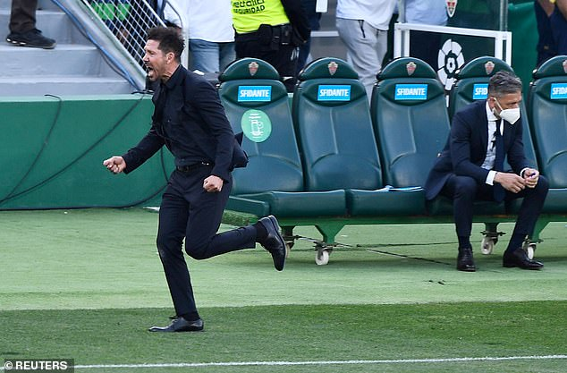 Diego Simeone (left) celebrates as Atletico Madrid beat Elche 1-0 to stay on top of La Liga