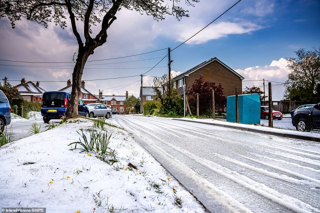 An extraordinary freak hail storm hit the Isle of Wight and covered the fields and streets in Newchurch turning the landscape into a winter wonderland