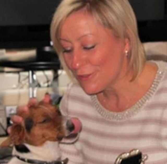 Julia James was walking her Jack Russell (pictured: Ms James and her dog) at the time of her death. The dog remained at the scene with her body, according to reports