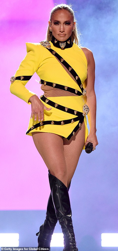 Second song:She performed her second song wearing an off-shoulder bright yellow mini-dress with a number of jewel-encrusted lion head figures attached in numerous places on the dress