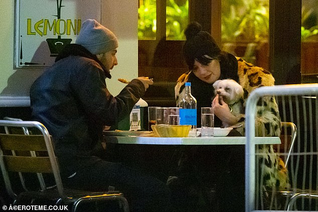 Loved up: The couple were first linked with each other in July and their relationship appears to still be strong as they enjoyed their meal on Sunday night