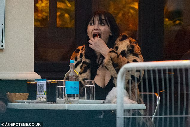 Tucking in: Daisy Lowe put on a busty display as she enjoyed a meal with boyfriend Jordan Saul and Maltese dog Monty at Greek restaurant Lemonia in Notting Hill on Sunday
