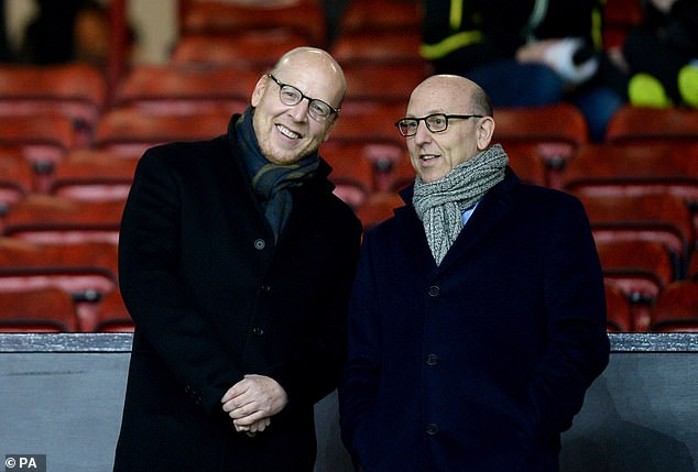 United supporters are trying to drive Joel Glazer (right) and Avram Glazer (left) out of the club
