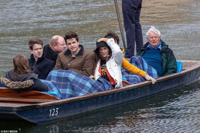 People under blankets as they brave the cold weather on Bank Holiday Monday as they go for a punt on the River Cam in Cambridge