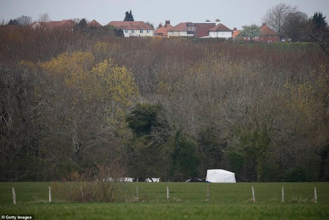 A police tent can be seen near Ackholt Woodon Sunday as officers search for evidence in the death of PCSO James