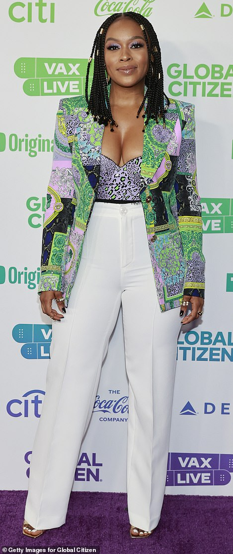 South African actress Nomzamo Mbatha rocked an eye-catching multipatterned blazer over a busy purple-and-green leopard-print top with white slacks
