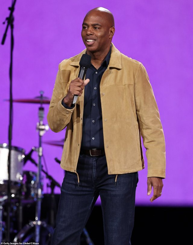 Casual cool: Entertainment Tonight co-host Kevin Frazier looked cool in a tan suede jacket with a black shirt and matching jeans
