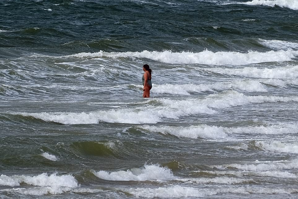One swimmer was spotted in just a swimming costume as she braved the chilly temperatures of the Bournemouth sea
