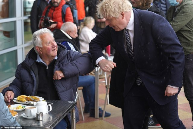 Mr Johnson elbow-bumped with a wide variety of locals on the windswept seafront in Hartlepool today