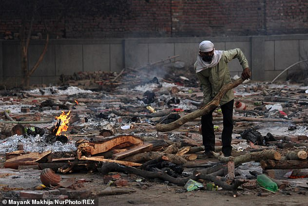 So far, the virus has killed 215,542 people, although experts believe the actual numbers of both cases and deaths are likely considerably higher. Pictured: A crematorium in New Delhi