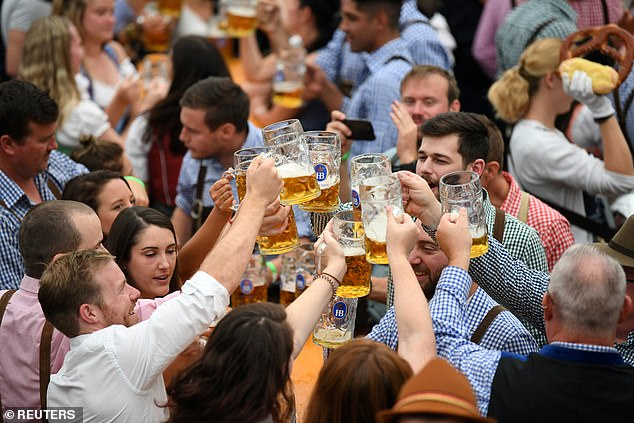 Germany's iconic Oktoberfest beer festival has been cancelled for the second year running due to the pandemic. Above, punters at the festival in 2019
