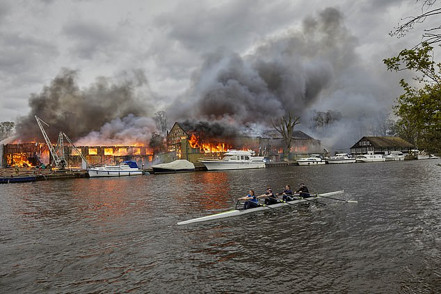 Footage from the scene shows the blaze raging over the small island, with black smoke pouring into the sky near several small boats