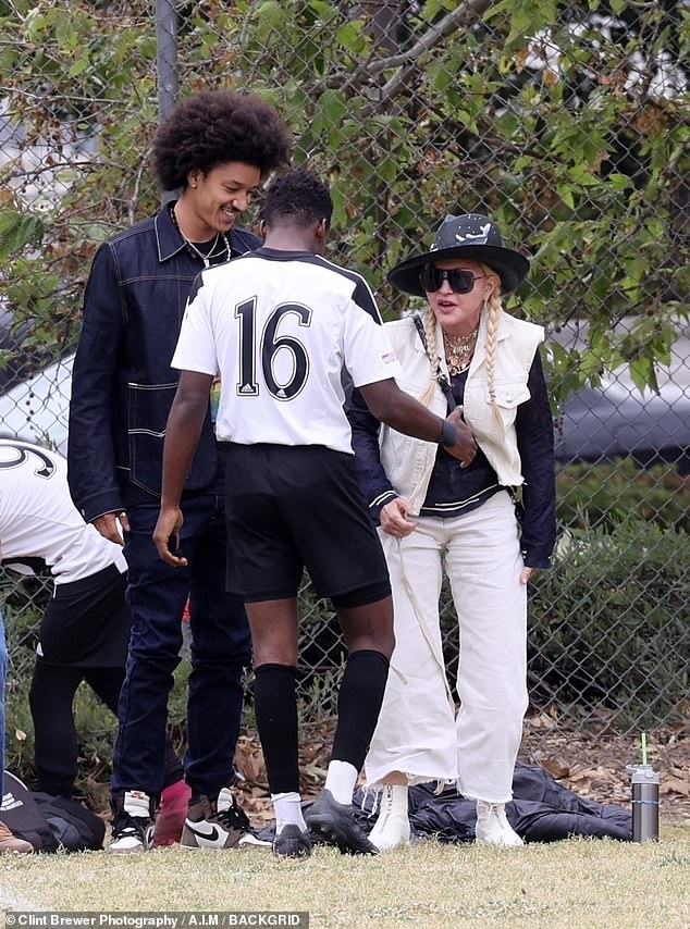 Support system: Madonna, 62, was seen cheering on her 15-year-old son David at his soccer match over the weekend while packing on the PDA with her 27-year-old toyboy boyfriend Ahlamalik Williams