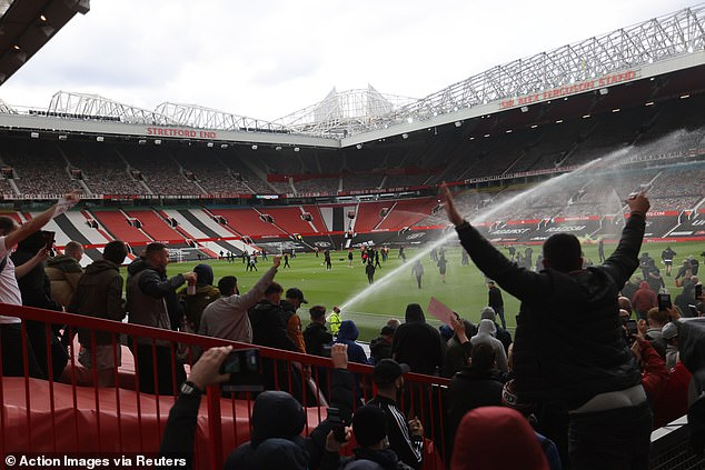 Hundreds of Red Devils supporters stormed the pitch at the stadium on Sunday afternoon