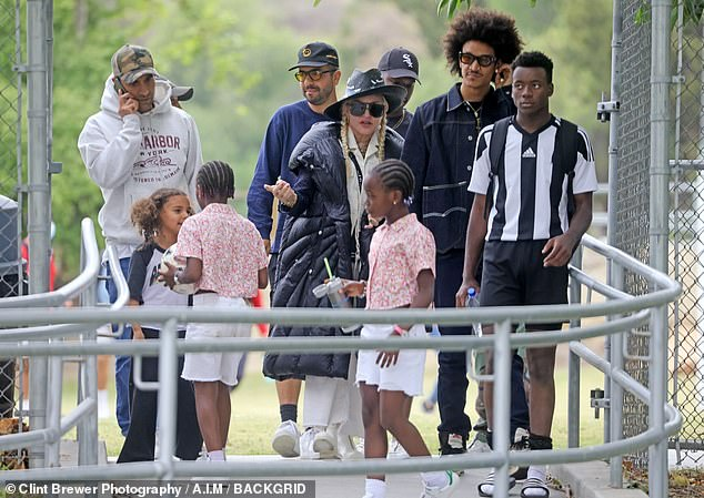 Squad goals: Young soccer star David had quite the cheering section in addition to Madonna and her younger beau as they were joined by plenty of friends and family