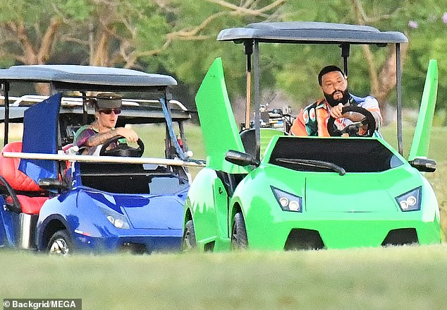 Finish line: Once the cameras started rolling, he and Justin were seen driving a pair of golf carts designed to look like luxury sports cars