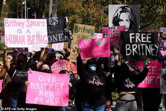 The pop star's fans have rallied behind a #FreeBritney movement supporting her in her fight for legal freedom from her father. She has been granted permission to address the judge in the case at a court hearing in LA on June 23 (protests pictured on March 17 in LA)