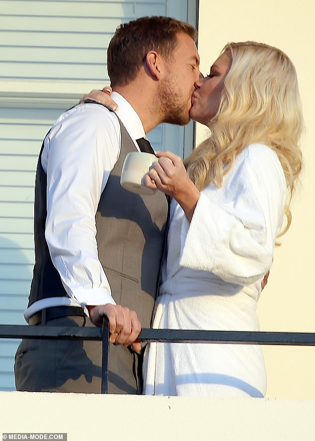 Get a room! Sophie Monk and fiancé Joshua Gross (pictured) packed on the PDA and shared a passionate kiss as they watched the sunset together in Melbourne on Friday