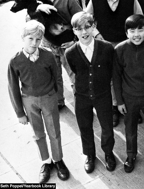 Bill (left) is pictured with friends in a childhood yearbook photo
