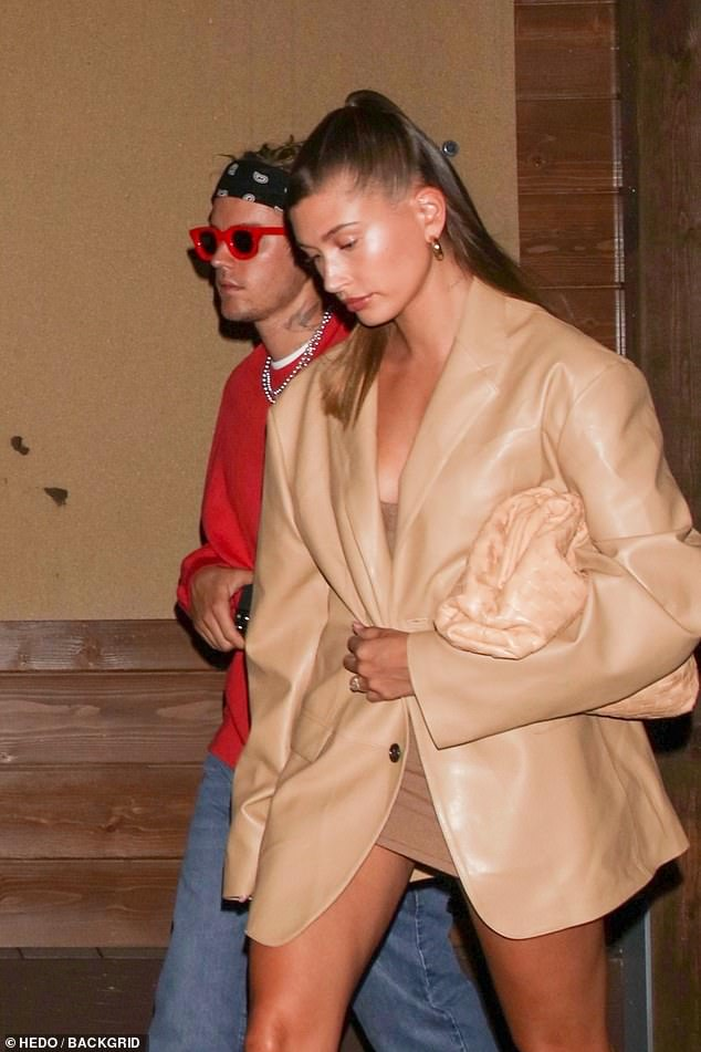 Chic:Hailey, 24, looked sublime in an oversized light tan leather blazer