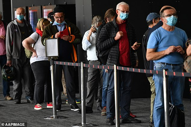 A 65-year-old Queensland man has claimed he had a stroke and went into a coma after receiving the AstraZeneca vaccine (pictured are people lining up in Melbourne to receive vaccine)