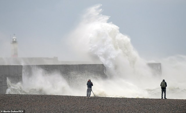 High winds, heavy and stormy seas batter the Newhaven lighthouse and harbour in East Sussex - which was one of the worst hit areas for wind last night