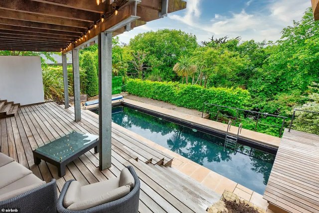 Fancy a swim?Outside, there is a pool in the garden, as well as a covered decking and seating area which looks out to the greenery to the back of the home