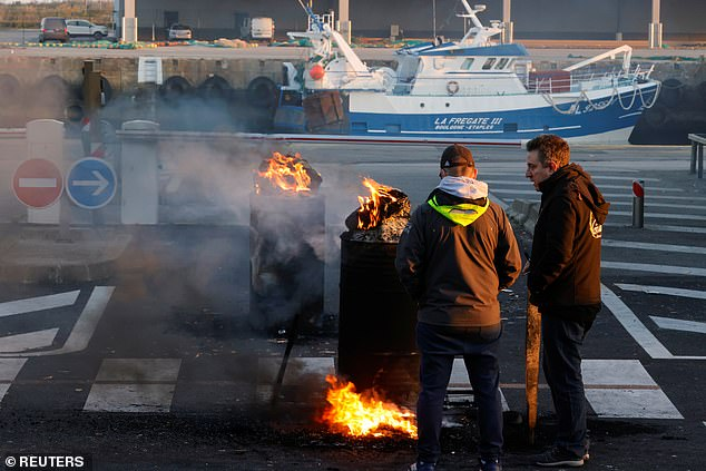 French fishermen block lorries carrying UK-landed fish at a protest at the fishing port in Boulogne-sur-Mer on April 23