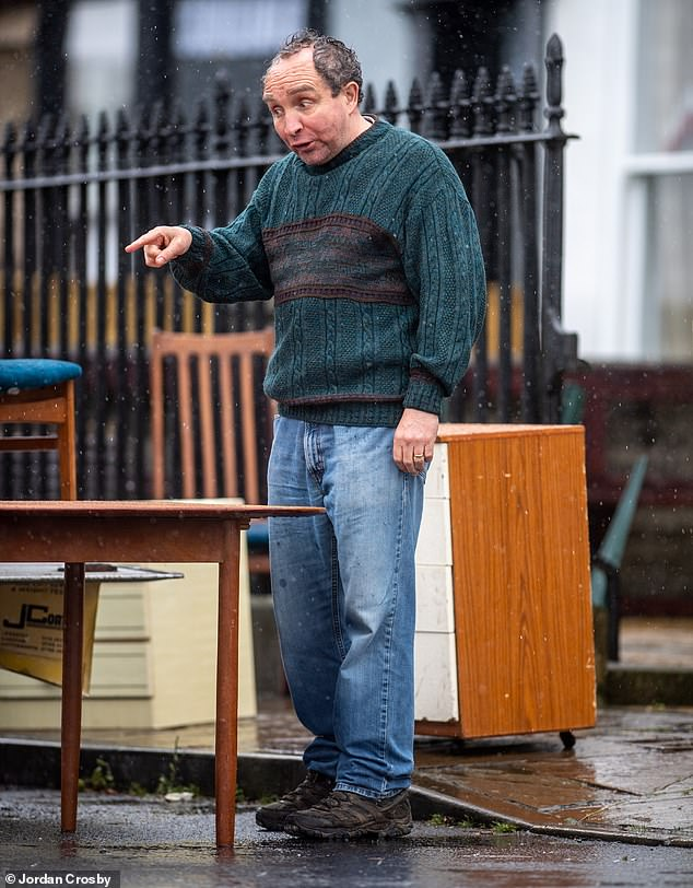 Downpour:During the latest scenes, Eddie got caught in a rain downpour as he wore a thick green jumper and jeans while dressed as conman John Darwin