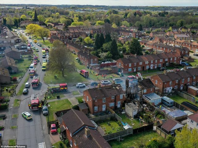 The scene in Ashford, Kent today as shown from the air, with seven fire engines and large numbers of police cars and ambulances in attendance