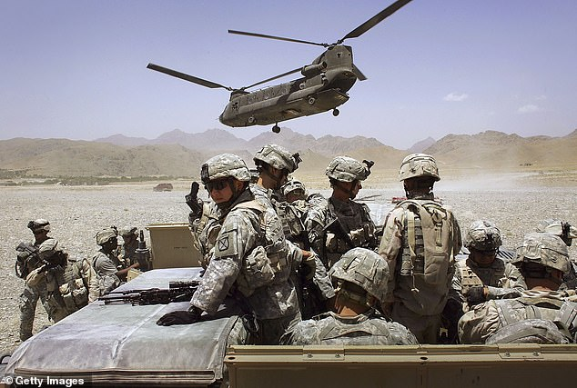 Biden's move appeared to ignore dates set by the Taliban and the Afghan government in their Doha deal in February last year (pictured: US soldiers in Deh Afghan in 2006)