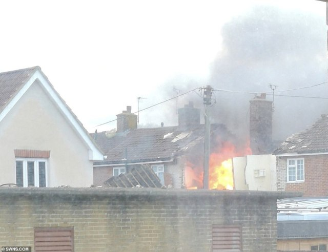 The fire burning after the blast, which saw the whole street evacuated over fears the explosion could have released asbestos