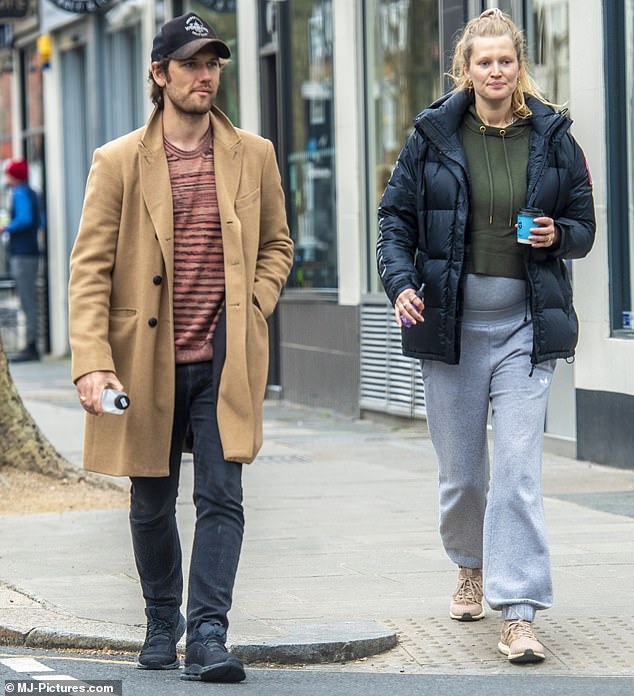 Preparing for the birth: The seven-month-pregnant model, 28, strolled down the road with her sweetheart, 31, before entering celebrity-favorite baby shop Blue Almonds in Kensington.