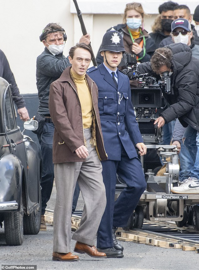 Action: Harry Styles was spotted donning a cop uniform as he filmed new drama My Policeman in Brighton opposite his on-screen gay lover David Dawson