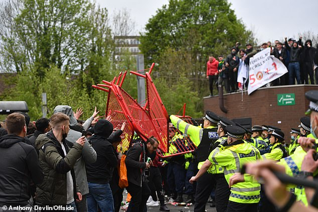 Fans clashed with police with metal railings being thrown in ugly scenes outside the ground