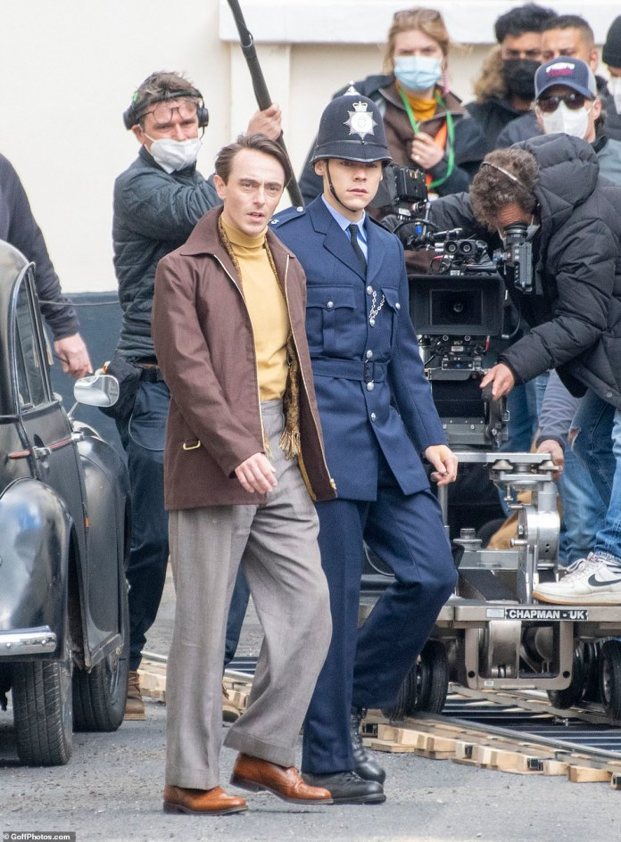 Action:On Tuesday, Harry donned a police uniform as he shot an outdoor scene alongside his on-screen lover David Dawson in Brighton
